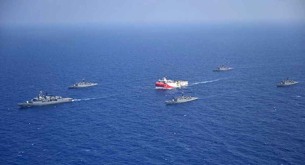 This handout photograph released by the Turkish Defence Ministry on August 12, 2020, shows Turkish seismic research vessel 'Oruc Reis' (C) as it is escorted by Turkish Naval ships in the Mediterranean Sea, off Antalya on August 10, 2020.