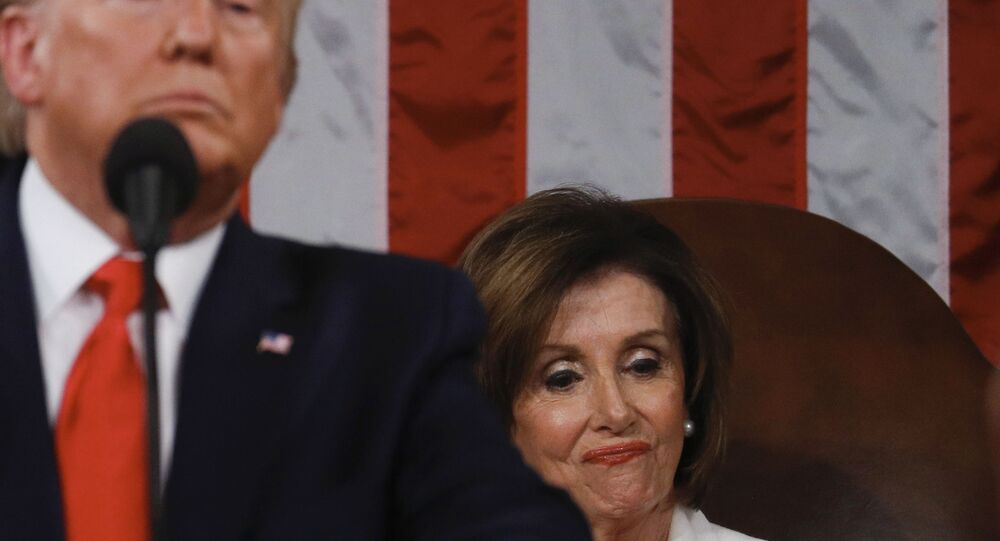 Speaker of the US House of Representatives Nancy Pelosi looks at a copy of US President Donald Trump's speech while he delivers the State of the Union address at the US Capitol in Washington, DC, on February 4, 2020.
