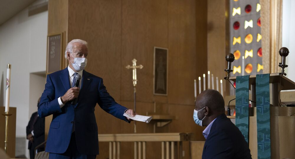 Democratic presidential candidate former Vice President Joe Biden speaks as he meets with members of the community at Grace Lutheran Church in Kenosha, Wis., Thursday, Sept. 3, 2020. (AP Photo/Carolyn Kaster)