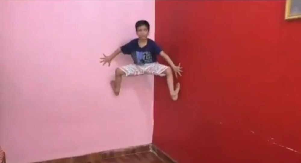 Yasharth Singh, 7, a real life Spider Man defying gravity and clinging to a wall of his home in Kanpur