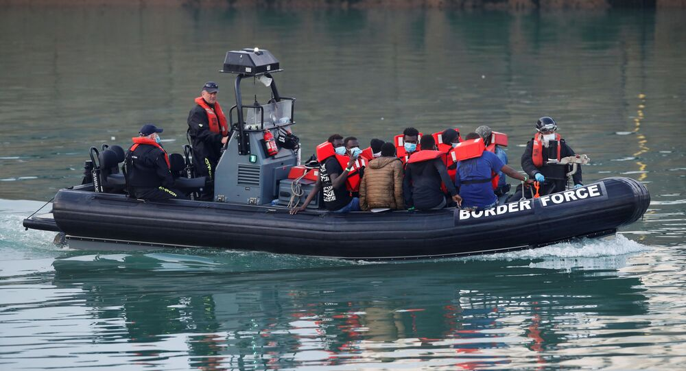 Migrants are brought to Dover harbour by Border Force, in Dover, Britain August 12, 2020