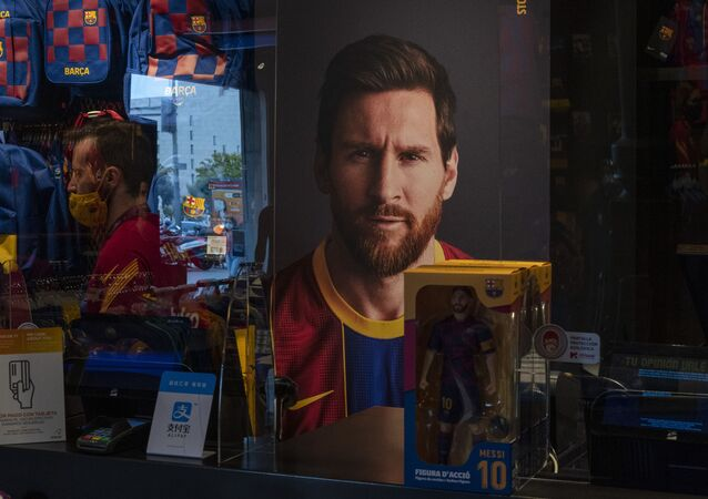 A poster with the face of Barcelona soccer player Lionel Messi is displayed at a F.C. Barcelona store in Barcelona, Spain on Tuesday, 1 September 2020