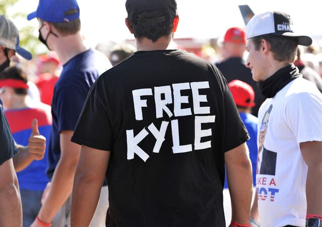 A man wears a shirt calling for freedom for Kyle Rittenhouse, 17, the man who allegedly shot protesters in Wisconsin, during a US President Donald Trump Campaign Rally, the day after the end of the Republican National Convention, at Manchester airport in Londonderry, New Hampshire on August 28, 2020