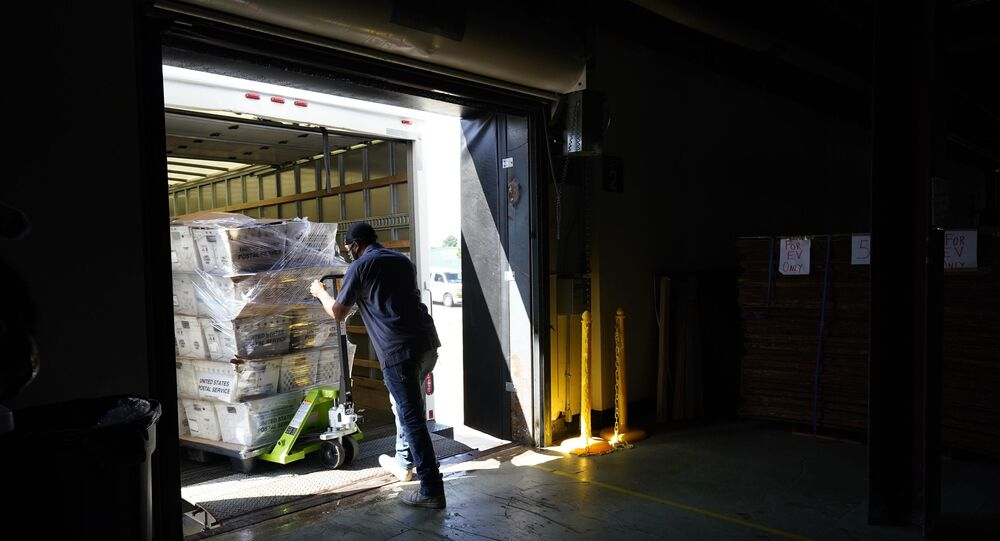 A load of absentee ballots are loaded onto a truck for mailing at the Wake County Board of Elections in Raleigh, North Carolina.