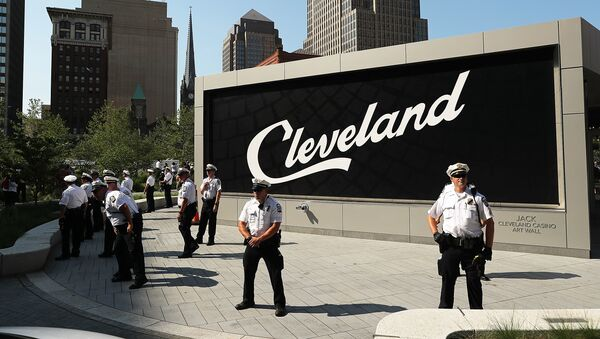 Police stand guard during protests near the sight of the Republican National Convention (RNC) in downtown Cleveland  - Sputnik International