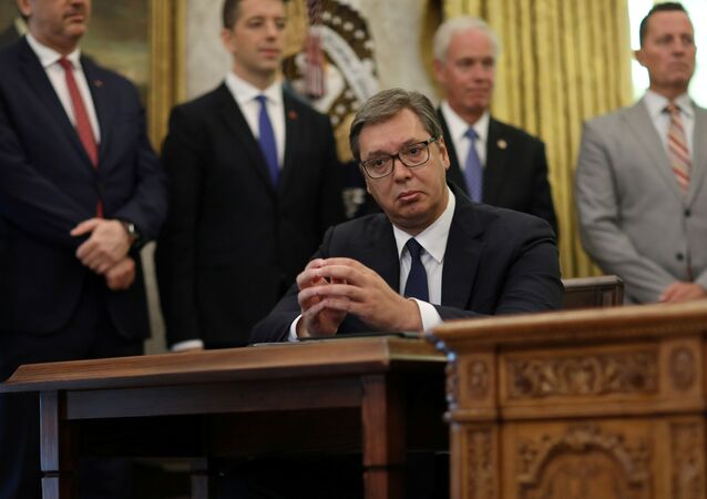 Serbia's President Aleksandar Vucic listens as U.S. President Donald Trump speaks during a signing ceremony with Kosovo's Prime Minister Avdullah Hoti at the White House in Washington, U.S., September 4, 2020.
