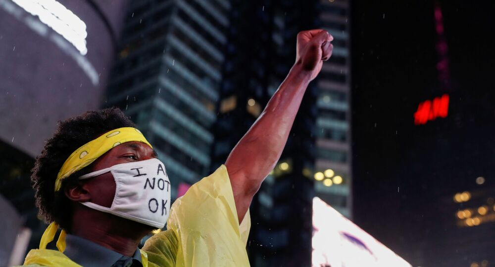 A demonstrator wearing a face mask raises his fist during a protest following the death of the Black man Daniel Prude, after police put a spit hood over his head during an arrest in Rochester on March 23, at Times Square in New York, U.S. September 3, 2020.