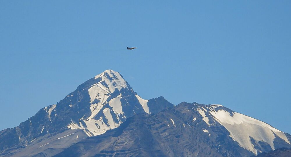 An Indian fighter jet flies over a mountain range in Leh, the joint capital of the union territory of Ladakh bordering China, on September 2, 2020.