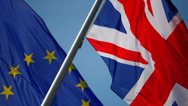 FILE PHOTO: European Union and British flags flutter in front of a chancellery ahead of a visit of British Prime Minister Theresa May in Berlin, Germany, April 9, 2019. - Sputnik International