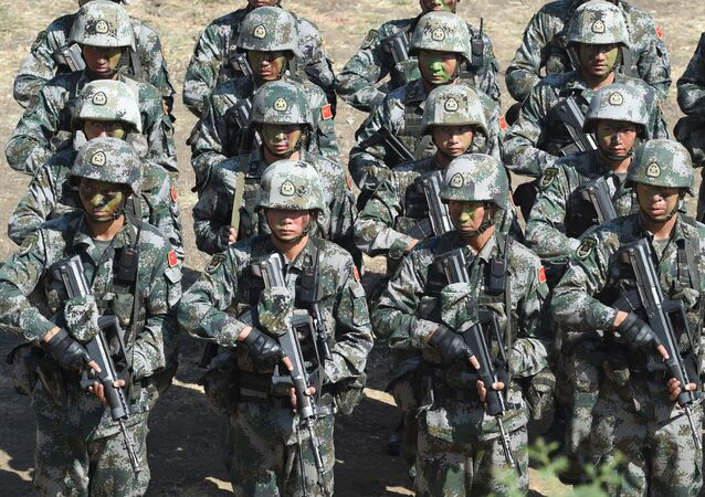 People's Liberation Army (PLA) of China soldiers line up after participating in an anti-terror drill during the Sixth India-China Joint Training exercise Hand in Hand 2016 at HQ 330 Infantry Brigade, in Aundh in Pune district, some 145km southeast of Mumbai, on November 25, 2016.