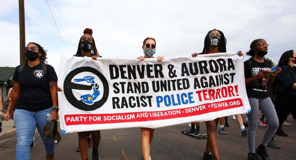 People march from Aurora to Denver to protest police violence in Colorado, U.S., August 30, 2020.  REUTERS/Kevin Mohatt