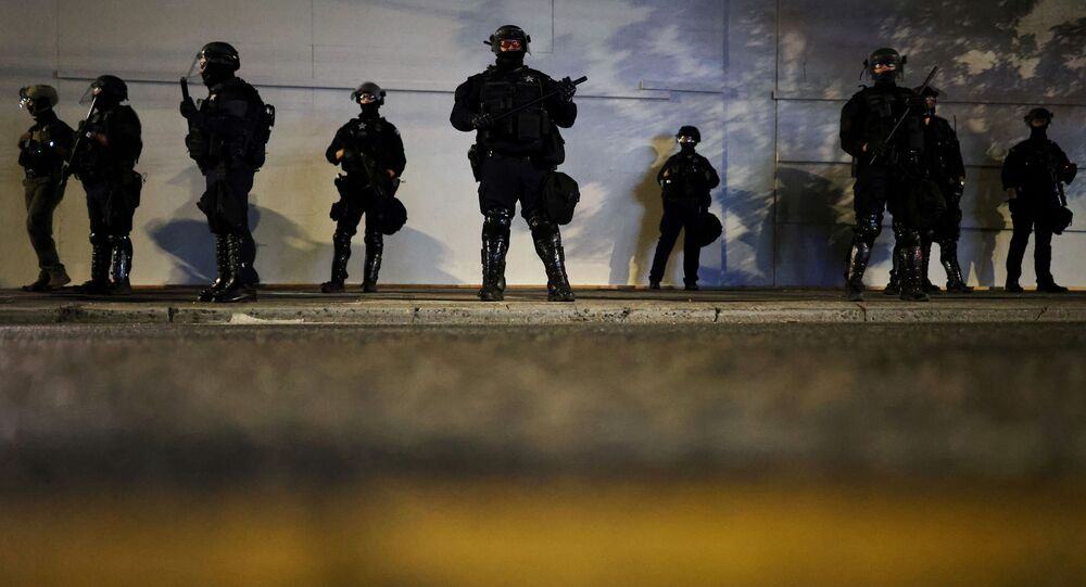 Police stand guard outside the Portland Police Bureau building as protesters demonstrate against police violence and systemic inequality for the 99th consecutive night in Portland, Oregon, U.S. September 4, 2020.