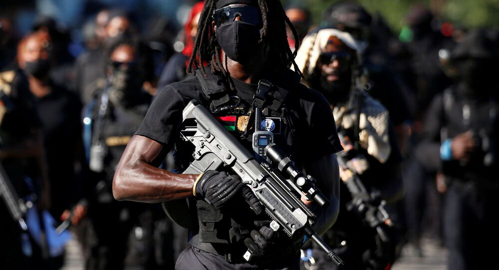 Members of a Black militia group called the NFAC march while armed in protest over the police killing of Breonna Taylor on the day of the Kentucky Derby horse race in Louisville, Kentucky, U.S. September 5, 2020.