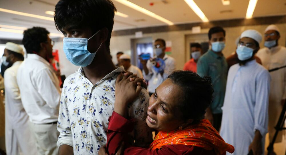 Relatives of victims mourn at a hospital, after a gas pipeline blast at a mosque in Narayanganj, near Dhaka, Bangladesh, September 5, 2020.