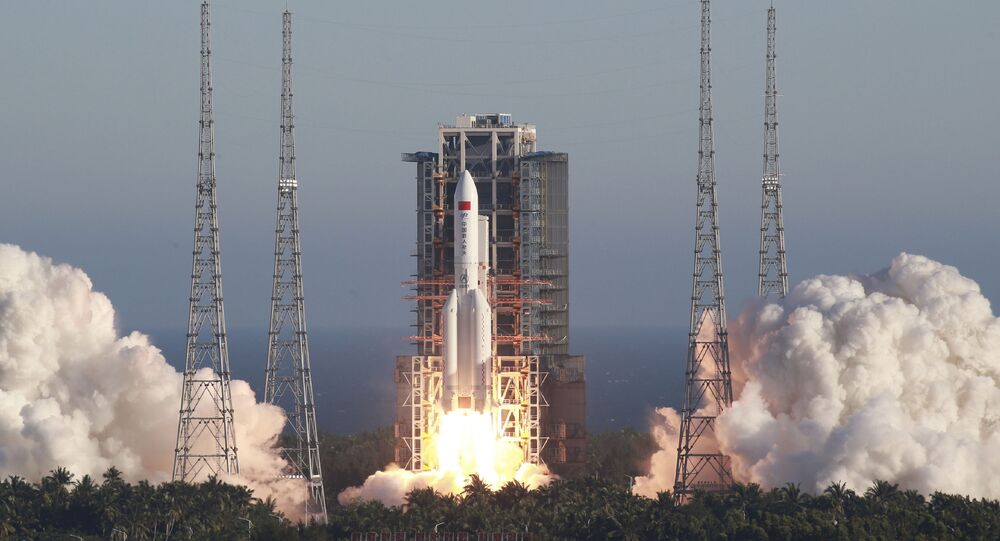 In this May 5, 2020, file photo released by Xinhua News Agency, China's new large carrier rocket Long March 5B blasts off from the Wenchang Space Launch Center in southern China's Hainan Province. An experimental version of China's latest-generation crewed shape ship is operating normally, the government says, despite an apparent malfunction aboard a cargo return capsule.