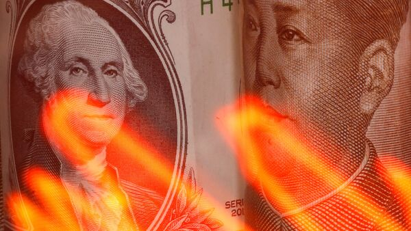 Chinese Yuan and U.S. dollar banknotes are seen behind illuminated stock graph in this illustration taken February 10, 2020.  - Sputnik International