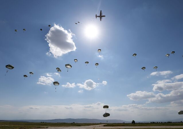 US Army paratroopers jump with parachutes from a Hercules C-130 military transport plane during Noble Partner 2020 multinational exercise, which involves servicemen from Georgia, the United States, the United Kingdom, Poland and France, at Vaziani military base outside Tbilisi, Georgia September 1, 2020.