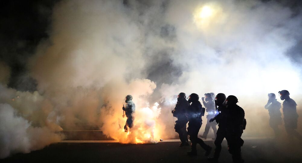 Portland Police officers disperse a crowd of protesters after a Molotov cocktail was thrown on the 100th consecutive night of protests in Portland, Oregon, U.S. September 5, 2020.