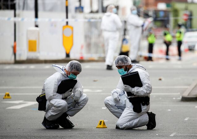 Forensics officers are seen near the scene of reported stabbings in Birmingham, Britain, September 6, 2020.