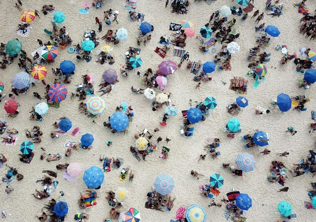 People enjoy at Ipanema beach, amid the coronavirus disease (COVID-19) outbreak, in Rio de Janeiro, Brazil September 6, 2020. Picture taken with a drone.