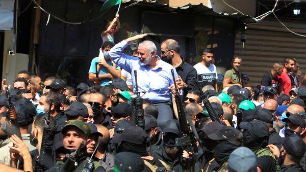 Palestinian group Hamas' top leader, Ismail Haniyeh, gestures as he is carried during his visit at Ain el Hilweh Palestinian refugee camp in Sidon, Lebanon September 6, 2020 - Sputnik International