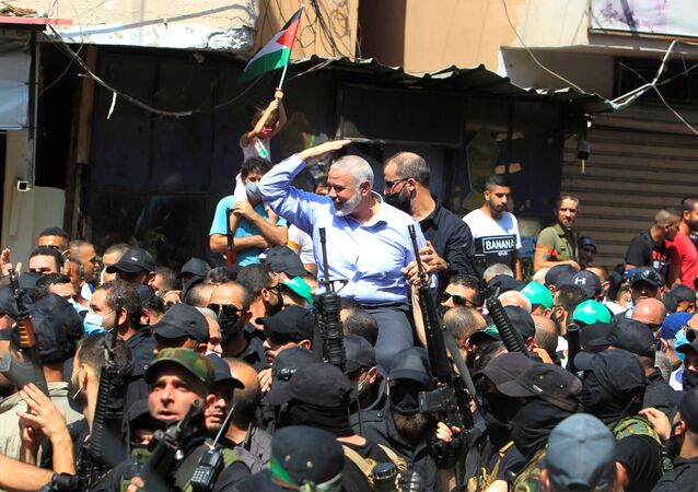 Palestinian group Hamas' top leader, Ismail Haniyeh, gestures as he is carried during his visit at Ain el Hilweh Palestinian refugee camp in Sidon, Lebanon September 6, 2020