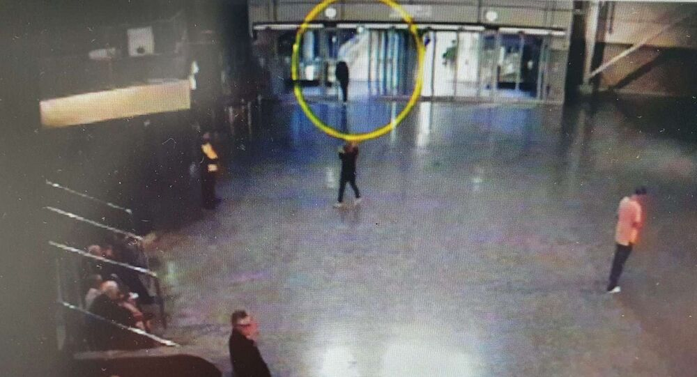 Salman Abedi (circled) is seen entering the Manchester Arena foyer moments before the bombing