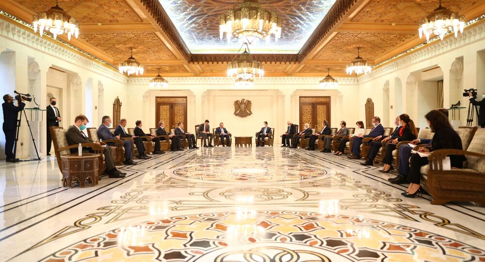 Russian Deputy Prime Minister Yuri Borisov, Foreign Minister Sergei Lavrov, Syrian President Bashar al-Assad and other officials attend a meeting in Damascus, Syria September 7, 2020