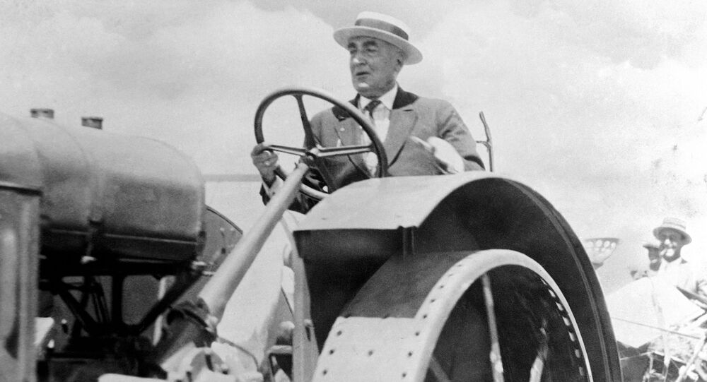 President Warren G. Harding drives a tractor, shortly before his death in August 1923.