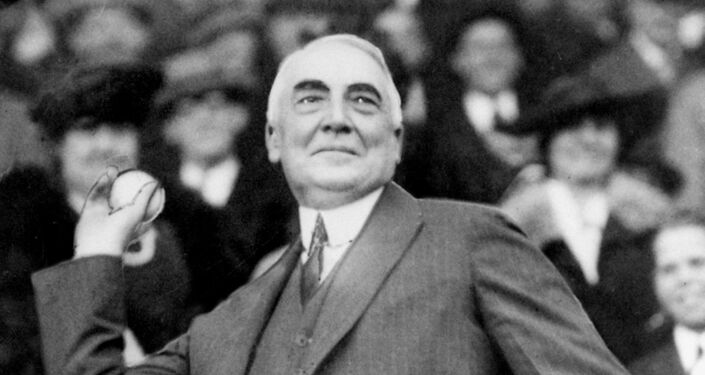 President Warren G. Harding throws out the first ball to open the Washington Senators' baseball season in 1921.