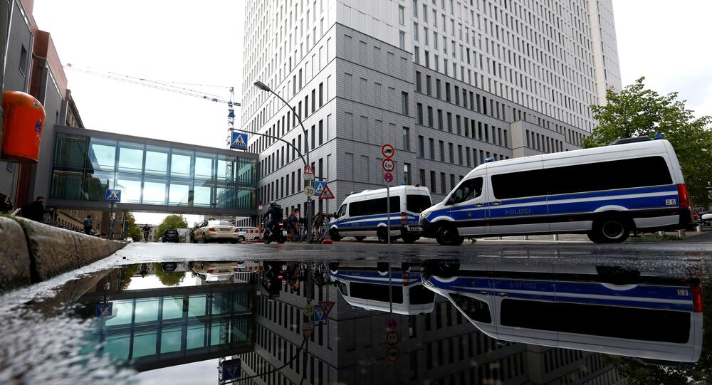 A view of police vehicles outside the Charite Mitte Hospital Complex, where Russian opposition leader Alexei Navalny is receiving medical treatment, in Berlin, Germany 24 August 2020.