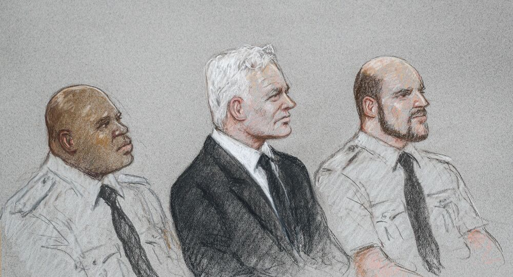 A courtroom sketch shows WikiLeaks founder Julian Assange during a hearing to decide whether he should be extradited to the United States, in London, Britain September 7, 2020 in this courtroom sketch. REUTERS/Julia Quenzler