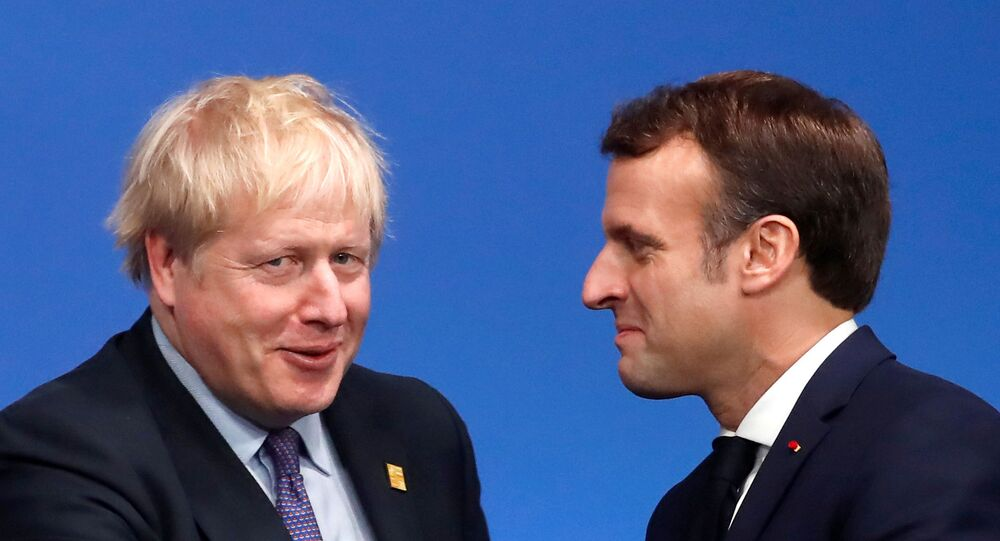 Britain's Prime Minister Boris Johnson welcomes France's President Emmanuel Macron at a NATO leaders summit in Watford, Britain on 4 December 2019.