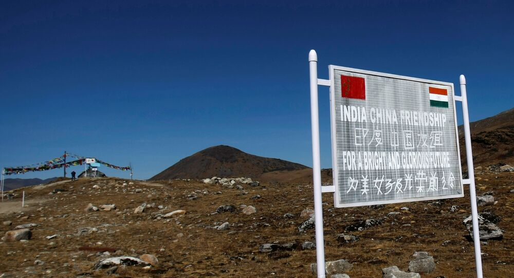 A signboard is seen from the Indian side of the Indo-China border at Bumla, in the northeastern Indian state of Arunachal Pradesh, November 11, 2009