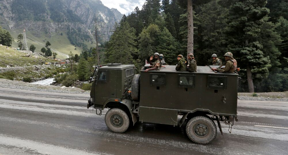 Indian army soldiers are seen atop a vehicle on a highway leading to Ladakh, at Gagangeer in Kashmir's Ganderbal district September 2, 2020.