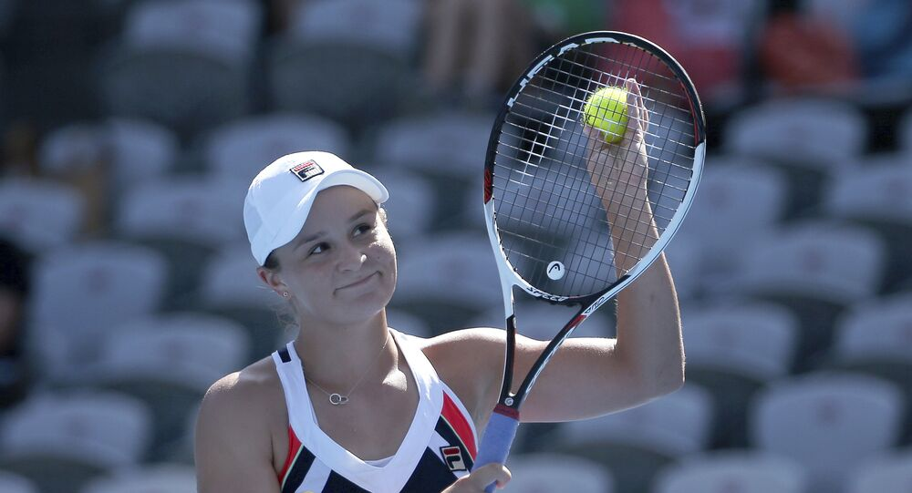 Ash Barty of Australia waves to the crowd after defeating compatriot Daria Gavrilova in their women's semifinal singles match at the Sydney International tennis tournament in Sydney, Friday, Jan. 12, 2018