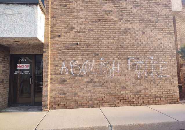 Photo shows Michigan Republican Party headquarters defaced with Abolish the police graffiti