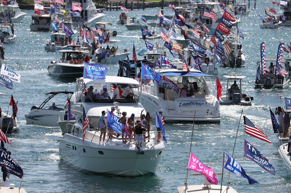 Boaters show their support for President Donald Trump at the start to a parade down the Intracoastal Waterway to just off the shore of President Trump's home at Mar-a-Lago on September 07, 2020 in West Palm Beach, Florida.