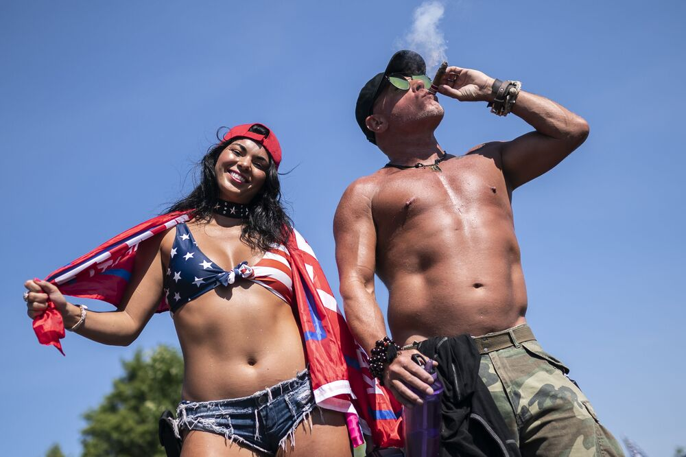 Elle, left, and Rock, who declined to give last names, pose for a portrait during a rally in support of President Trump on September 7, 2020 in Clackamas, Oregon.
