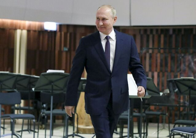 Russian President Vladimir Putin walks to deliver an address, during the opening of the Concert Hall in the Zaryadye Park near the Kremlin marking the Day of the City in Moscow, Russia, Saturday, 5 September 2020.