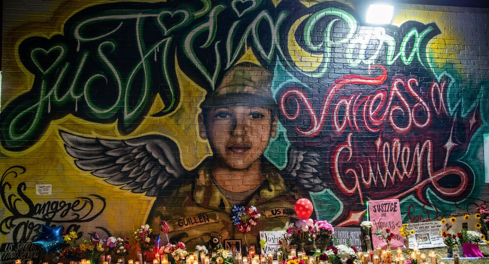 Flowers adorn a mural of Vanessa Guillen, a soldier based at nearby Fort Hood on July 6, 2020 in Austin, Texas.