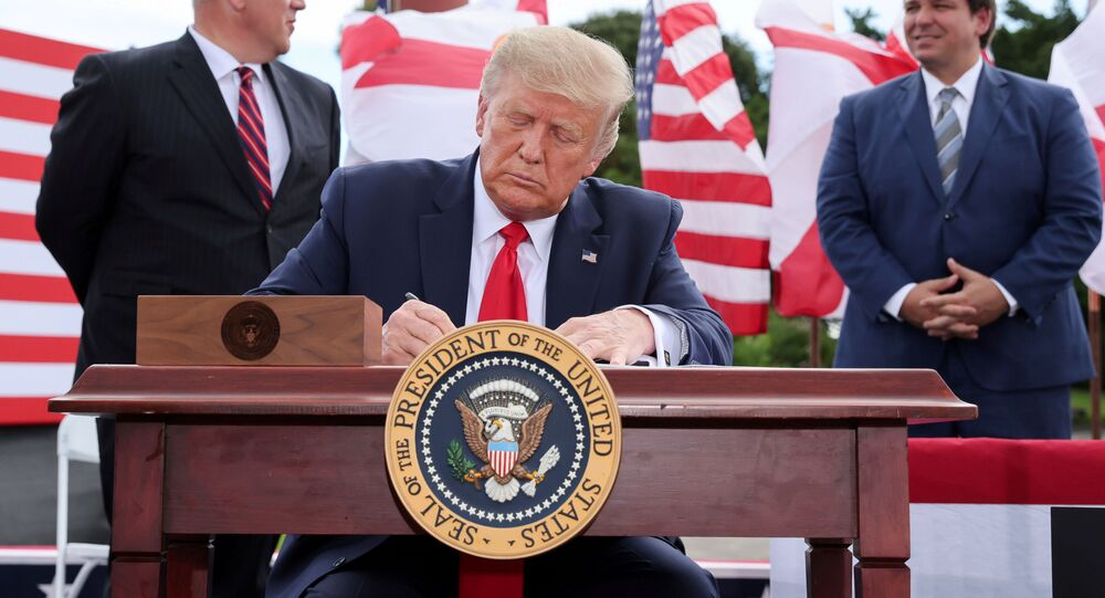 U.S. President Donald Trump signs an extension of the ban on offshore drilling off the coast of the state of Florida in front of a crowd of Trump supporters as U.S. Secretary of the Interior David Bernhardt and Florida Governor Ron DeSantis look on in Jupiter, Florida, U.S. September 8, 2020.