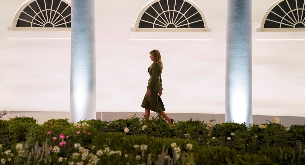 U.S. first lady Melania Trump walks up the White House West Wing colonnade as she arrives to deliver her live address to the largely virtual 2020 Republican National Convention from the Rose Garden of the White House in Washington, U.S., August 25, 2020. REUTERS/Kevin Lamarque     TPX IMAGES OF THE DAY