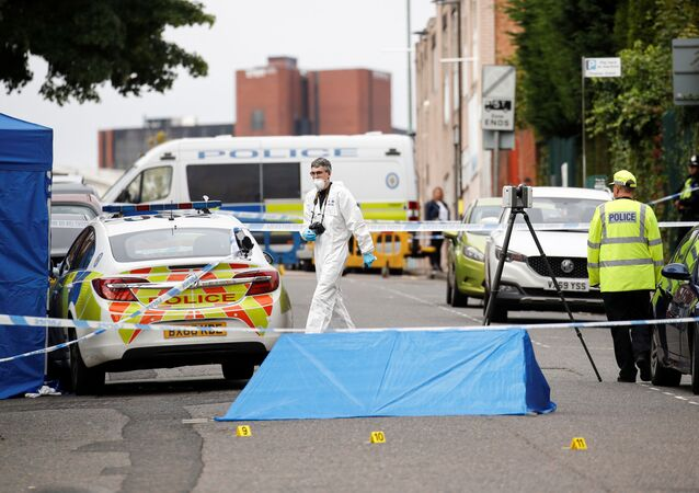 Police officers and a forensic worker are seen at the scene of reported stabbings in Birmingham, Britain, September 6, 2020.