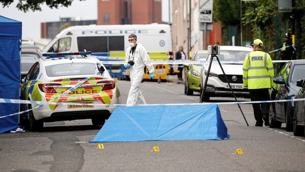 Police officers and a forensic worker are seen at the scene of reported stabbings in Birmingham, Britain, September 6, 2020. - Sputnik International