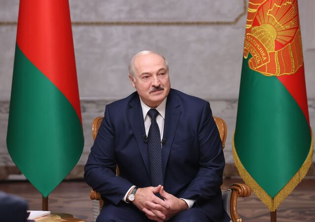 Belarusian President Alexander Lukashenko speaks during an interview to Russian journalists at the Independence Palace in Minsk, Belarus