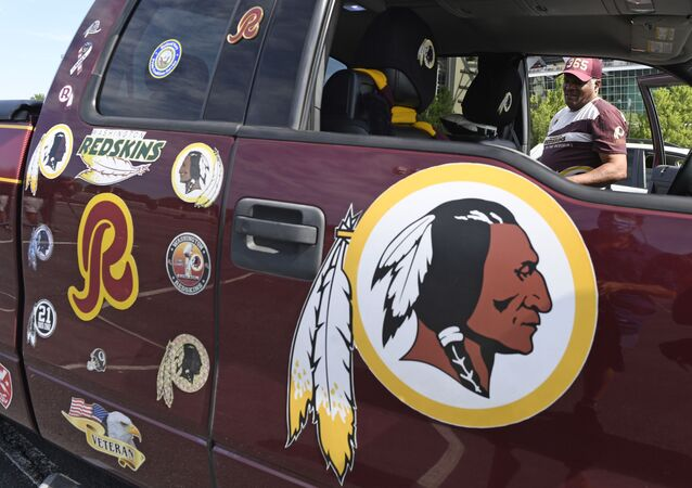 Rodney Johnson of Chesapeake, Va., stands with his truck outside FedEx Field in Landover, Md., Monday, July 13, 2020
