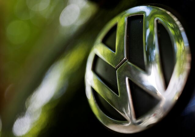 A logo of German carmaker Volkswagen is seen on a car parked on a street in Paris, France, July 9, 2020