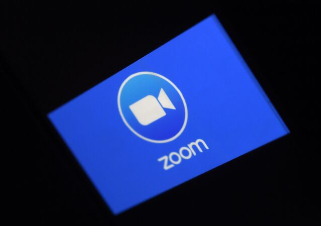 In this file photo illustration a Zoom App logo is displayed on a smartphone on March 30, 2020 in Arlington, Virginia. - Zoom shares soared on August 31 after the video-meeting service reported that quarterly revenue rocketed as its ranks of users more than quadrupled