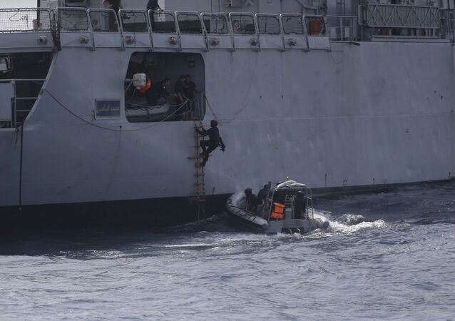 In this photo taken on Wednesday March 20 2019, Nigeria Naval Special Forces patrol during a joint navy exercise, in the Gulf of Guinea. The United States Navy and 33 other countries recently carried out weeks of maritime training in the Gulf of Guinea, to improve safety against pirates and to improve the monitoring of the West Africa coastline